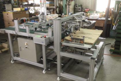 自動給袋機能付クラフト袋印字用搬送装置